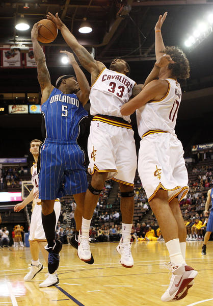 Cleveland Cavaliers guard Alonzo Gee (33) blocks the shot of the Orlando Magic forward Quentin Richardson (5) during the first half at US Bank Arena.