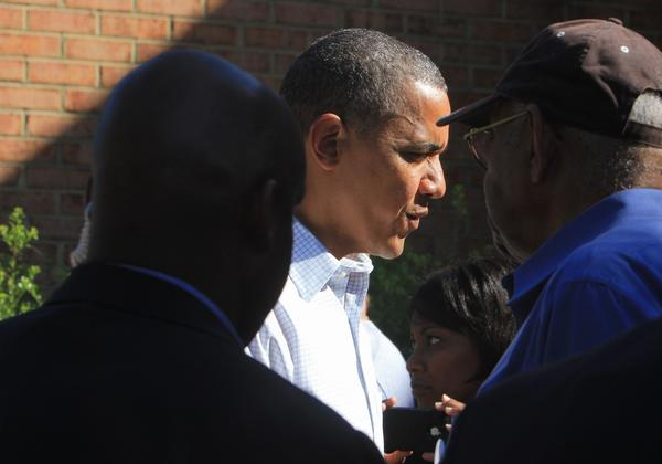 President Barack Obama speaks with supporters during a stop at a local campaign office in Williamsburg on Sunday.