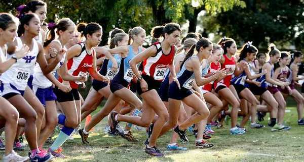 The girls' varsity cross country start at a Pacific League meet at County Park in Arcadia.
