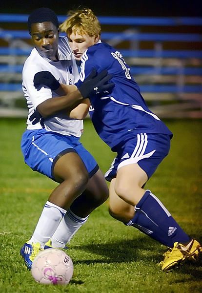 Boonsboro's Twanda Mukudzavhu, left, and FSK's Brendon Dooley battle for the ball during the first half of Monday night's game.