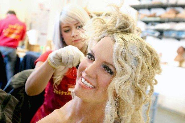 Britney Spears' wax figure has her hair curled by stylist Colleen Sluss in the Studio of Madame Tussauds Hollywood.