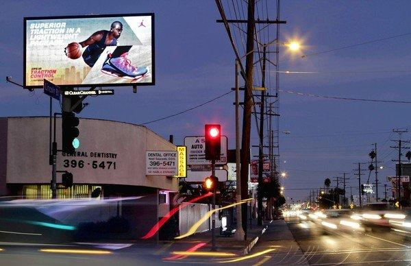"A Venice resident says this digital billboard on Lincoln Boulevard shines into her room. Councilmen Ed Reyes and Paul Krekorian say a new deal could bring the city a ""significant"" chunk of digital billboard revenue."