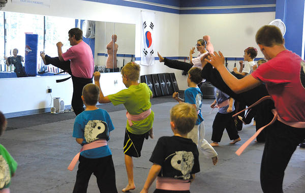 Students at White Tiger Martial Arts in Hagerstown participate in a kickathon at the school to raise money for the Susan G. Komen Fund Walk to fight breast cancer.