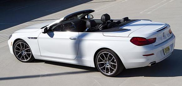 """The flexibility of the 650i enables the four-seater to go toe-to-toe with a variety of competitors, namely the Jaguar XK convertible and Mercedes SL550 and at times, the Porsche 911 Cabriolet. <br> <a href=""""http://www.latimes.com/business/autos/la-fi-autos-bmw-650i-convertible-revi20110707,0,7056013.story""""><u>See full story</u></a>"""