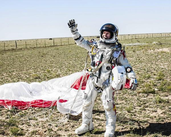 This picture provided by www.redbullcontentpool.com shows pilot Felix Baumgartner of Austria celebrating after successfully completing the final manned flight for Red Bull Stratos in Roswell, New Mexico on October 14, 2012.