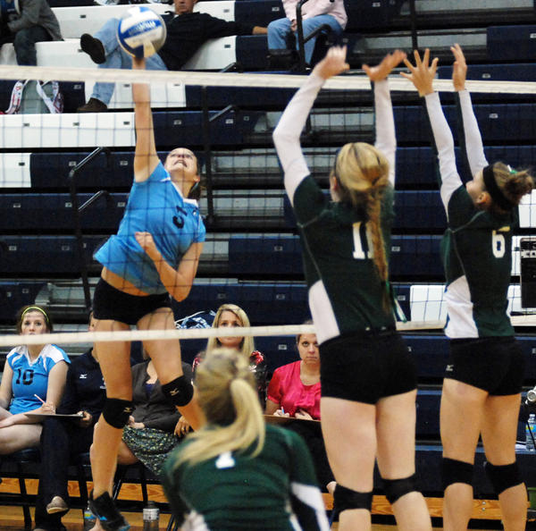 Petoskey's Liz Fraser (left) had 12 kills and nine digs Monday as the Northmen dropped a Big North Conference league match at Traverse City West.
