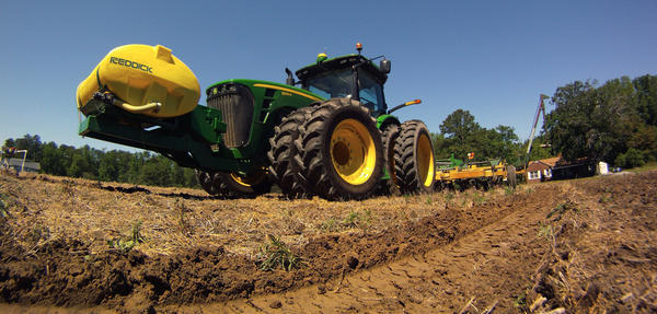 J.V. Oliver, III uses a GPS equipped tractor to plant, arrow straight, strip-tilled rows of cotton off of Route 10 in Suffolk Friday, May 11, 2012.