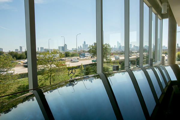 The southeast-facing showroom has two lifts to move cars between its four stories, with full views of Chicago's skyline.