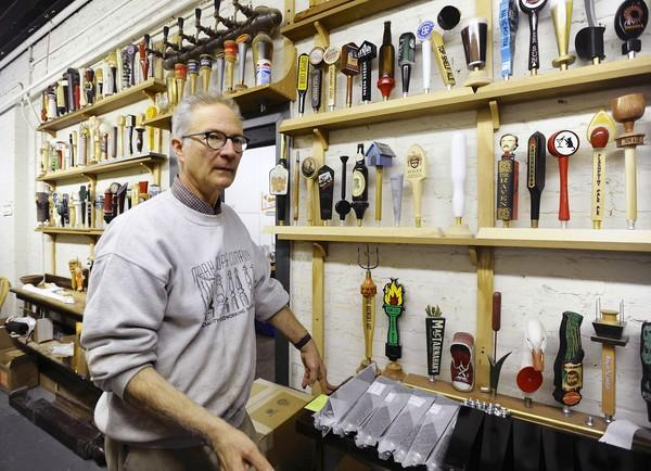 In the world of tap handles, Mark Supik's shop has emerged as the preferred provider of custom-designed tap handles for the regional brewers, microbrewers and start-ups that compose the craft-beer movement.