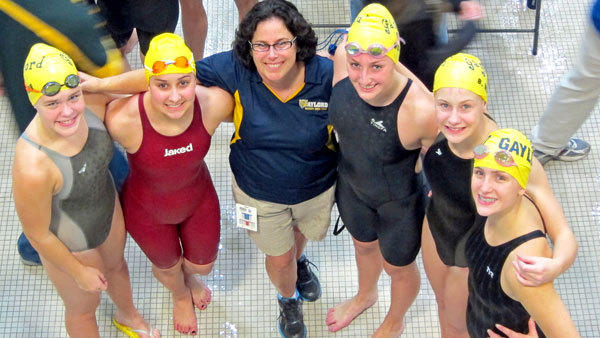 Coach Barb Switalski stands with relay members that broke a pair of school records at the Michigan Interscholastic Coaches Association meet at Eastern Michigan University, the 200 medley relay and the 400 freestyle relay. Pictured is Haley Hope, Julia Klokner, Cierra Woods, Bianca Weir and Caroline Davis (l-r). The medley relay also set a state-qualifying mark.