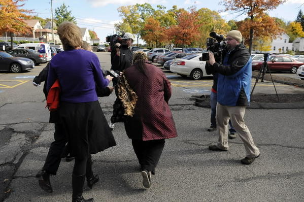 Candace Bednarz walks through a gauntlet of media as she heads to her car upon leaving Manchester Superior Court after attending the arraignment of her brother, Brett Bednarz, who is charged in the 2010 triple murder of their mother, Beverly Therrien and two tenants at Therrien's East Hartford home.