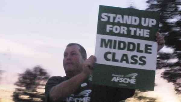 Village employee and Local 368 member Sam Brokop pickets outside Orland Park Village Hall Monday,