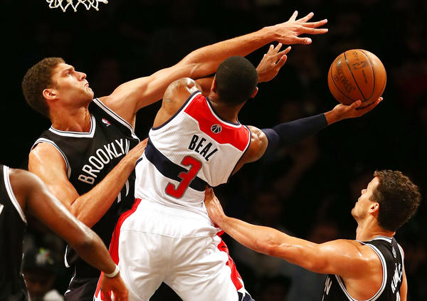 Bradley Beal #3 of the Washington Wizards drives to the basket as Brook Lopez #11 of the Brooklyn Nets defends during a preseason game at the Barclays Center on October 15, 2012 in the Brooklyn borough of New York City.