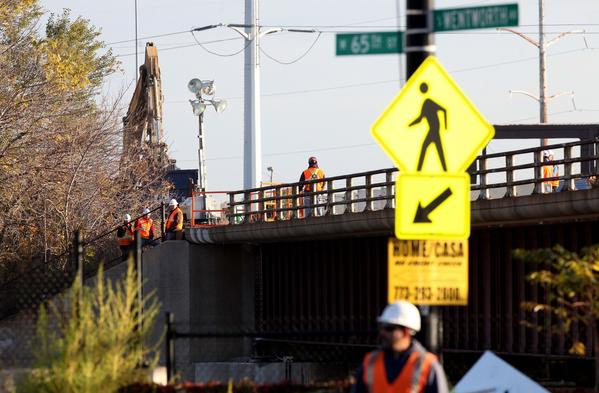 Engineers and construction workers on the scene of a railroad bridge over the Dan Ryan Expressway near 65th and Wentworth Avenue that may have been damaged by a subcontractor.