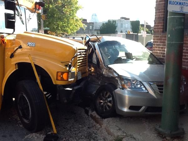 Thirteen people were reported injured after a school bus and car collided.