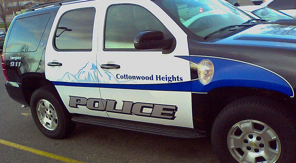 Cottonwood Heights police say they aren't responsible for a pit bull's injuries that resulted while officers were breaking up a conflict between the dog and a border collie.
