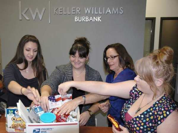 Thank a Soldier committee members filling a postal box to be sent to a soldier are, from left, Natalie Barash, Holly Patterson, Valene Rolon and Amanda Bebout. All are employees with Keller Williams Realty in Burbank.