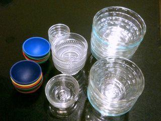 The glass and rubber cups pictured above are handy for holding spices and prepared ingredients until they're ready to go in a recipe, and can be found at many major markets and cooking supply stores.