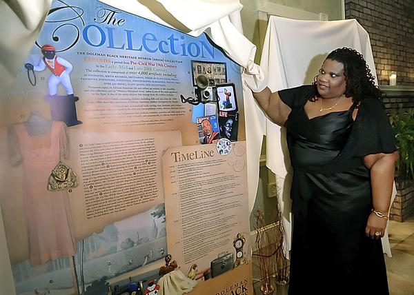 Alesia Parson-McBean, administrator of the Doleman Black Heritage Museum, shows one of the mobile exhibits that was unveiled at a fundraiser at Cortlandt Mansion for the Doleman Black Heritage Museum in this Herald-Mail file photo.