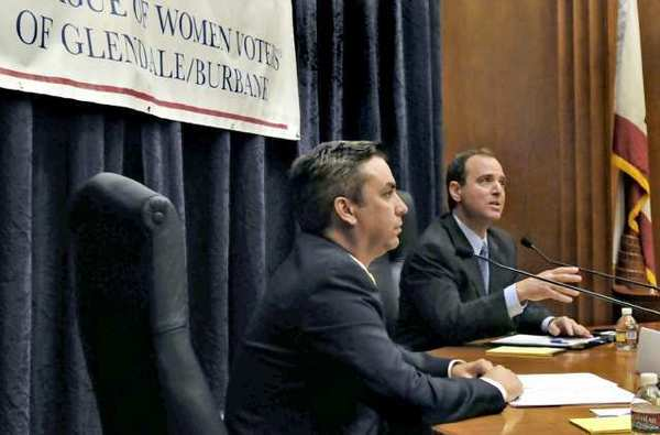 Congressman Adam Schiff, right, and challenger Phil Jennerjahn participate in a debate for the new 28th Congressional District at the Burbank City Hall.