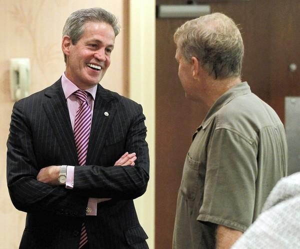 "Former Sen. Norm Coleman (R-Minn.), pictured in August, gave the opening address at a meeting of Mitt Romney donors and leaders of the ""super PAC"" Restore Our Future. Coleman is a foreign policy advisor for Romney."