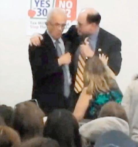 Brad Sherman (D-Sherman Oaks), right, throws his arm around rival Howard Berman (D-Valley Village) during a recent heated debate.
