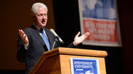 Clinton, speaking in Baltimore, says he's optimistic on budget