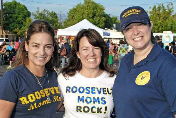 The 2012 Roosevelt Elementary School Fall Festival Picnic was made possible by, from left, PTA President Gema Sanchez, Chairwoman Nicole Kvarda and Principal Jennifer Meglemre.