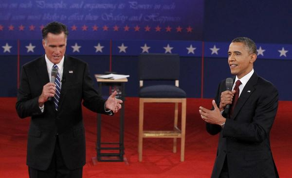President Barack Obama (R) and Republican presidential nominee Mitt Romney (L) during the second presidential debate in Hempstead, New York Tuesday.