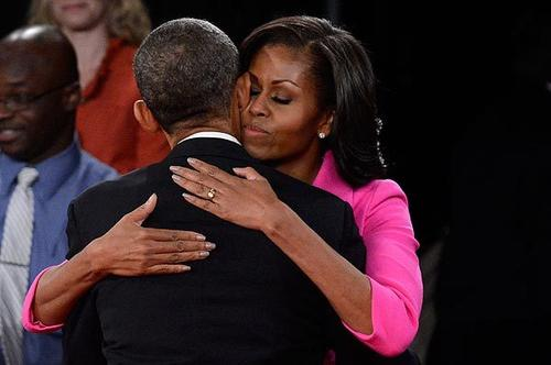 President Obama and his wife, First Lady Michelle Obama, embrace after the presidential debate at Hofstra University.