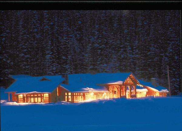 The warm glow of the Brooks Lake Lodge main lodge reaches out into a cold Wyoming winter night.