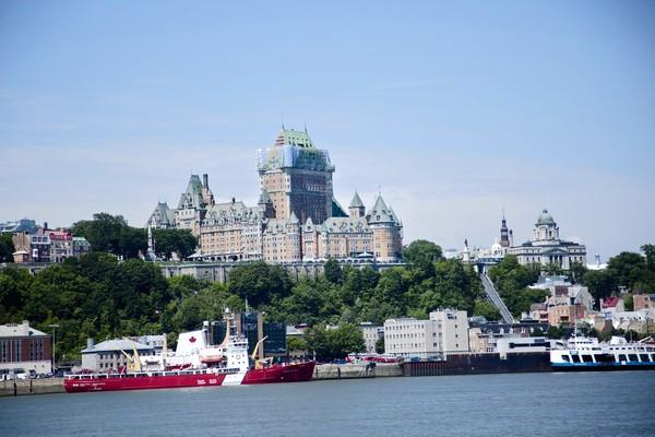 Fairmont Le Chateau Frontenac towers above the riverfront in Quebec City's Old Town. The hotel is the city's most recognizable building.