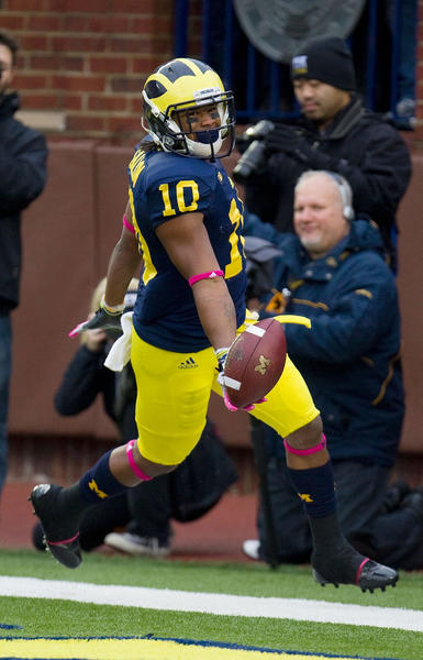 Jeremy Gallon of the Michigan Wolverines celebrates a first quarter touchdown while playing the Illinois Fighting Illini at Michigan Stadium.