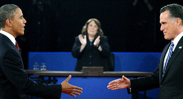 President Barack Obama and Republican presidential candidate Mitt Romney arrive on stage for the second presidential debate at Hofstra University, moderated by Candy Crowley of CNN.