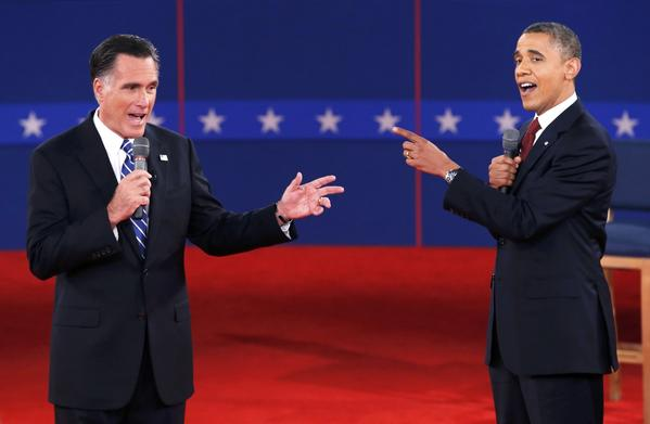 U.S. Republican presidential nominee Mitt Romney and President Barack Obama speak directly to each other during the second U.S. presidential debate in Hempstead, N.Y.
