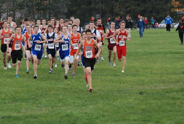 Harbor Springs sophomore Marcus Garrow (front) leads the pack at the start of Tuesday's Lake Michigan Conference championship at East Jordan's Community Park. Garrow finished runner up to East Jordan's Josh Wojan (far right) as the Harbor boys won the league title.