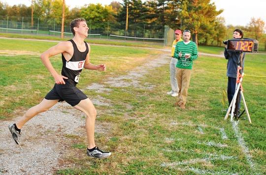 George Rogers Clark cross country runner Grayson Brookshire crosses the finish line during the ¿Run for the Water Barrel¿ race Tuesday at Lykins Park.