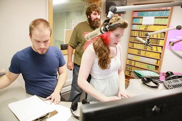 Elmhurst College deejays Nate Brandel, from left, Brian Lamberty and Colleen Kelly check out the renovated studio.