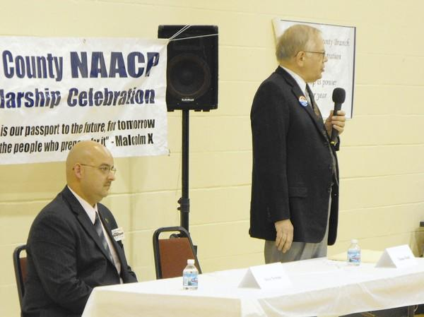Lake County coroner candidates Republican Steve Newton, right, and Democrat Dr. Thomas Rudd share the spotlight a forum in Waukegan Oct. 13.