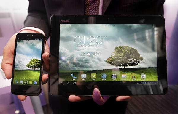 Asus' new product Padfone 2, which combines smartphone and tablet PC functions, is presented during a media launch in Taipei. The Padfone 2 will be priced starting at NT$17,901 ($597).