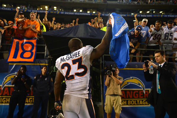 Denver Broncos running back Willis McGahee walks off the field holding San Diego Chargers wide receiver Antwan Barnes' (not pictured) jersey after the Broncos beat the Chargers 35-24 at Qualcomm Stadium. The Chargers scored 24 points in the first half, only to be routed by Peyton Manning and the Denver defense who hung 35 on San Diego in the second half.