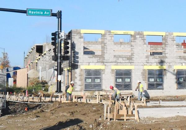"Construction work is underway on the Ninety 7 Fifty luxury apartment building west of 143rd and LaGrange Road. The complex is scheduled to be completed in August. Orland Park's newest Historic Preservation Review commissioner, Marianne ""Mimi"" Citarella, is also the leasing agent for the apartment"