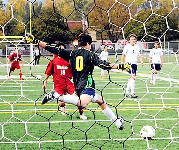 New Trier High School goalkeeper Justin Dunn kicks during a sophomore match against Hinsdale Central High School on Oct. 11. Athletes at the North Shore school are not currently charged to participate in sports, but that could change as the school board finance committee looks to change its fee structure.