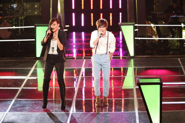"Emily Earle (left) and Mackenzie Bourg perform on ""The Voice."""