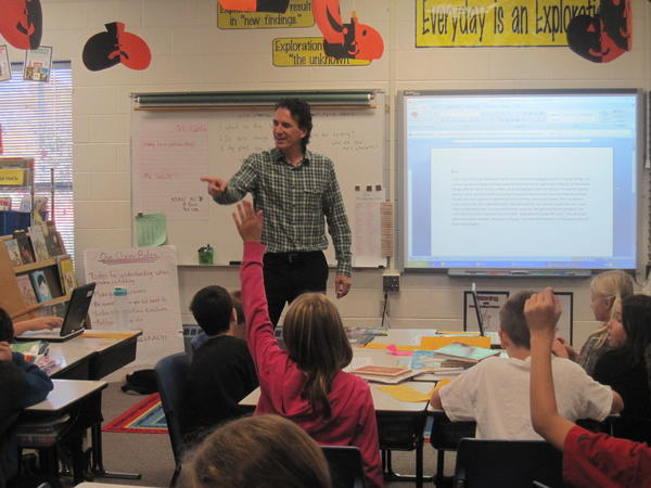 Children's author Antonio Sacre works with River Woods Elementary students in Naperville to improve their writing skills.