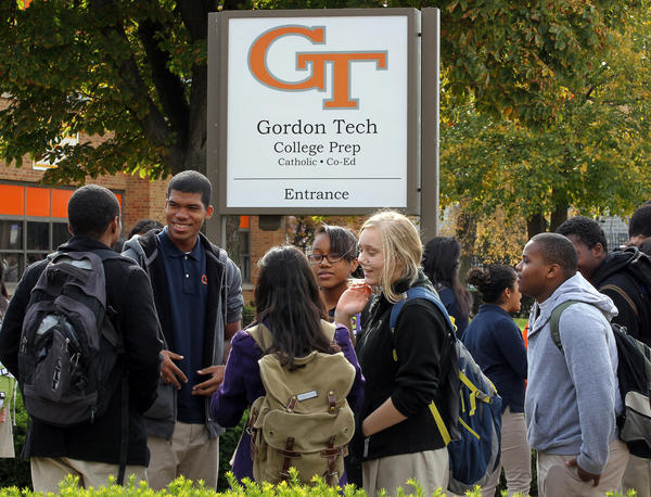 Gordon Tech students converge outside after completing standardized testing exams at the school.