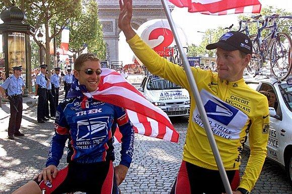 Christian Valde Velde and Lance Armstrong after the final stage of the 1999 Tour de France.  (Laurent Rebours / Special to the Tribune)
