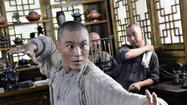 "The first clue that Stephen Fung's ""Tai Chi Zero"" is not your usual kung-fu kickfest is when our hero -- Yang Lu Chan (Yuan Xiaochao) -- is introduced on a 19th century Chinese battlefield to the strains of heavy metal. And then, for several minutes that follow, it becomes a silent film complete with title cards."