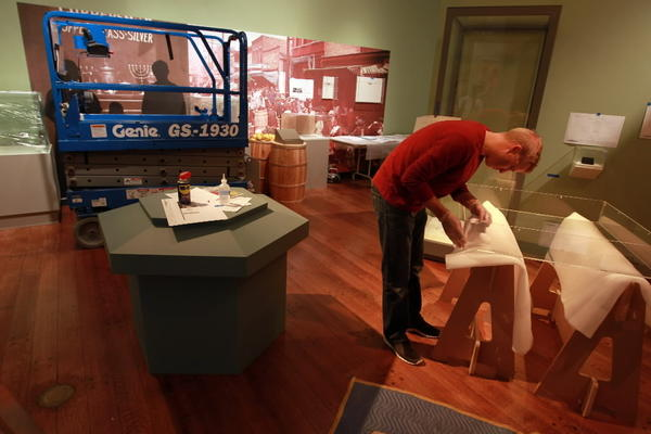 "Michael Burmeister prepares the new ""Shalom Chicago"" exhibit at the Chicago History Museum, about the history of the Jewish community in Chicago dating back to the 1840s."