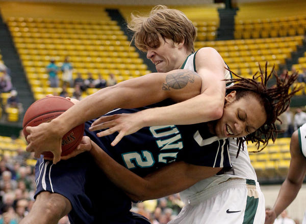 Tim Rusthoven of William & Mary battles for the rebound with Keith Rendlemen of UNC Wilmington during the first half at W&M.